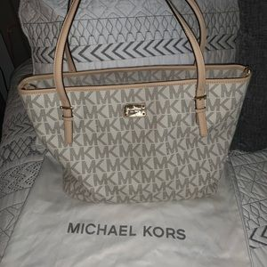 Michael Kors baby changing bag with a mat